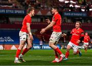 5 March 2021; Mike Haley, left, celebrates with Munster team-mates Jack O'Donoghue and Craig Casey after scoring his side's second try during the Guinness PRO14 match between Munster and Connacht at Thomond Park in Limerick. Photo by Ramsey Cardy/Sportsfile