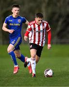 6 March 2021; Jack Malone of Derry City gets past Andy Lyons of Bohemians during the Pre-Season Friendly match between Bohemians and Derry City at the AUL Complex in Clonshaugh, Dublin. Photo by Piaras Ó Mídheach/Sportsfile