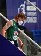 7 March 2021; Séan Tobin of Ireland leaves the track wearing a facemask after finishing 11th in the Men's 3000m Final during the second session on day three of the European Indoor Athletics Championships at Arena Torun in Torun, Poland. Photo by Sam Barnes/Sportsfile
