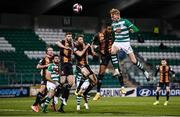 12 March 2021; Liam Scales of Shamrock Rovers heads at goal under pressure from Sonni Nattestad of Dundalk during the FAI President's Cup Final match between Shamrock Rovers and Dundalk at Tallaght Stadium in Dublin. Photo by Harry Murphy/Sportsfile