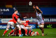 12 March 2021; Nick McCarthy of Munster perfroms a box kick under pressure from Sam Lousi of Scarlets during the Guinness PRO14 match between Munster and Scarlets at Thomond Park in Limerick. Photo by Ramsey Cardy/Sportsfile