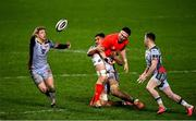 12 March 2021; Angus O'Brien of Scarlets intercepts a pass from Billy Holland of Munster, as he is tackled by Sam Lousi of Scarlets during the Guinness PRO14 match between Munster and Scarlets at Thomond Park in Limerick. Photo by Ramsey Cardy/Sportsfile