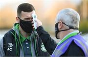19 March 2021; Aaron Greene of Shamrock Rovers has his temperature taken by Shamrock Rovers COVID officer Eugene Coppinger on arrival before the SSE Airtricity League Premier Division match between Shamrock Rovers and St Patrick's Athletic at Tallaght Stadium in Dublin. Photo by Stephen McCarthy/Sportsfile