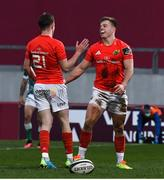 19 March 2021; Alex McHenry of Munster is congratulated by team-mate Nick McCarthy after scoring their side's first try during the Guinness PRO14 match between Munster and Benetton at Thomond Park in Limerick. Photo by Matt Browne/Sportsfile