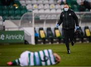 19 March 2021; Shamrock Rovers physiotherapist Tony McCarthy runs onto the pitch to give medical attention to Aaron Greene of Shamrock Rovers during the SSE Airtricity League Premier Division match between Shamrock Rovers and St Patrick's Athletic at Tallaght Stadium in Dublin. Photo by Stephen McCarthy/Sportsfile