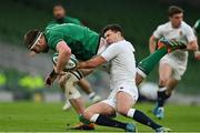 20 March 2021; Iain Henderson of Ireland beats the tackle of Ben Youngs of England during the Guinness Six Nations Rugby Championship match between Ireland and England at Aviva Stadium in Dublin. Photo by Brendan Moran/Sportsfile