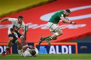 20 March 2021; Iain Henderson of Ireland skips the tackle by Kyle Sinckler of England during the Guinness Six Nations Rugby Championship match between Ireland and England at Aviva Stadium in Dublin. Photo by Ramsey Cardy/Sportsfile