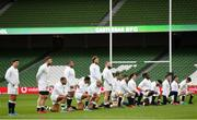 20 March 2021; Members of the England team take a knee in support of Rugby Against Racism prior to the Guinness Six Nations Rugby Championship match between Ireland and England at the Aviva Stadium in Dublin. Photo by Ramsey Cardy/Sportsfile