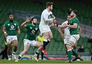 20 March 2021; Elliot Daly of England in action against Robbie Henshaw and Iain Henderson of Ireland during the Guinness Six Nations Rugby Championship match between Ireland and England at Aviva Stadium in Dublin. Photo by Brendan Moran/Sportsfile