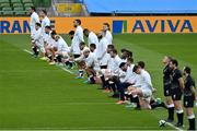 20 March 2021; The England team take a knee for the 'Rugby Against Racism' campaign prior to the Guinness Six Nations Rugby Championship match between Ireland and England at Aviva Stadium in Dublin. Photo by Brendan Moran/Sportsfile
