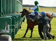 21 March 2021; Church Mountain and jockey James Doyle are helped into the stalls by stall handlers before the start of the Royal Lytham At Irish Emerald Stud C & G Maiden at The Curragh Racecourse in Kildare. Photo by Seb Daly/Sportsfile