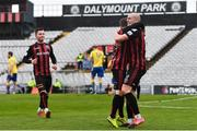 27 March 2021; Georgie Kelly of Bohemians, right, celebrates with team-mates, including Liam Burt, after scoring his side's first goal during the SSE Airtricity League Premier Division match between Bohemians and Longford Town at Dalymount Park in Dublin. Photo by Sam Barnes/Sportsfile