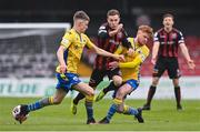 27 March 2021; Liam Burt of Bohemians is tackled by Aodh Dervin, right, and Paddy Kirk of Longford Town during the SSE Airtricity League Premier Division match between Bohemians and Longford Town at Dalymount Park in Dublin. Photo by Sam Barnes/Sportsfile