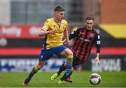 27 March 2021; Paddy Kirk of Longford Town in action against Liam Burt of Bohemians during the SSE Airtricity League Premier Division match between Bohemians and Longford Town at Dalymount Park in Dublin. Photo by Sam Barnes/Sportsfile