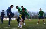 29 March 2021; Jason Knight with Republic of Ireland team-mates Alan Browne, centre, Troy Parrott and coach Keith Andrews during a Republic of Ireland training session at the Debrecen Football Academy in Debrecen, Hungary. Photo by Stephen McCarthy/Sportsfile