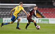 27 March 2021; Liam Burt of Bohemians in action against Paddy Kirk of Longford Town during the SSE Airtricity League Premier Division match between Bohemians and Longford Town at Dalymount Park in Dublin. Photo by Sam Barnes/Sportsfile