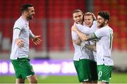 30 March 2021; James McClean of Republic of Ireland celebrates after scoring his side's first goal with team-mates, from left, Shane Duffy, Jeff Hendrick and Robbie Brady during the international friendly match between Qatar and Republic of Ireland at Nagyerdei Stadion in Debrecen, Hungary. Photo by Stephen McCarthy/Sportsfile