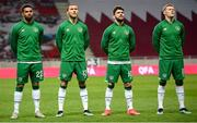 30 March 2021; Republic of Ireland players, from left, Cyrus Christie, Jeff Hendrick, Robbie Brady and James McClean of Republic of Ireland stand for the playing of the National Anthem before the international friendly match between Qatar and Republic of Ireland at Nagyerdei Stadion in Debrecen, Hungary. Photo by Stephen McCarthy/Sportsfile