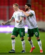 30 March 2021; Republic of Ireland's James McClean, left, celebrates with team-mate Robbie Brady after scoring his side's goal during the international friendly match between Qatar and Republic of Ireland at Nagyerdei Stadion in Debrecen, Hungary. Photo by Stephen McCarthy/Sportsfile