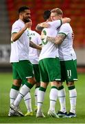 30 March 2021; Republic of Ireland's James McClean, right, celebrates with team-mates Shane Long and Cyrus Christie, left, after scoring his side's goal during the international friendly match between Qatar and Republic of Ireland at Nagyerdei Stadion in Debrecen, Hungary. Photo by Stephen McCarthy/Sportsfile