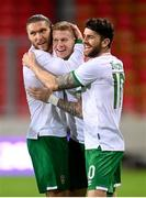 30 March 2021; Republic of Ireland's James McClean celebrates with team-mates Robbie Brady, right, and Jeff Hendrick, left, after scoring his side's goal during the international friendly match between Qatar and Republic of Ireland at Nagyerdei Stadion in Debrecen, Hungary. Photo by Stephen McCarthy/Sportsfile