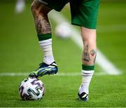 """30 March 2021; A detailed view of tattoo's on the legs of James McClean of Republic of Ireland featuring an autism awareness symbol and the text of """"The Serenity Prayer"""" before the international friendly match between Qatar and Republic of Ireland at Nagyerdei Stadion in Debrecen, Hungary. Photo by Stephen McCarthy/Sportsfile"""
