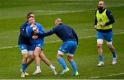 1 April 2021; Jordan Larmour is tackled by Jack Conan, left, and Rhys Ruddock during the Leinster Rugby captains run at the RDS Arena in Dublin. Photo by Ramsey Cardy/Sportsfile