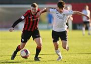 2 April 2021; Joe Gorman of Longford Town in action against Johnny Kenny of Sligo Rovers during the SSE Airtricity League Premier Division match between Longford Town and Sligo Rovers at Bishopsgate in Longford. Photo by Harry Murphy/Sportsfile