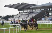 3 April 2021; Runners and riders race past the empty grandstand during the Boomerang.ie Maiden hurdle race on day one of the Fairyhouse Easter Festival at the Fairyhouse Racecourse in Ratoath, Meath. Photo by David Fitzgerald/Sportsfile
