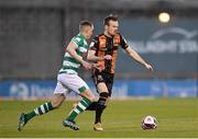 2 April 2021; Cameron Dummigan of Dundalk in action against Sean Kavanagh of Shamrock Rovers during the SSE Airtricity League Premier Division match between Shamrock Rovers and Dundalk at Tallaght Stadium in Dublin. Photo by Seb Daly/Sportsfile