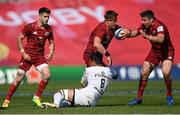 3 April 2021; CJ Stander of Munster, supported by Conor Murray, left, and Niall Scannell, right,  is tackled by Jerome Kaino of Toulouse during the Heineken Champions Cup Round of 16 match between Munster and Toulouse at Thomond Park in Limerick. Photo by Ramsey Cardy/Sportsfile