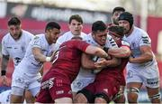 3 April 2021; Selevasio Tolofua of Toulouse is tackled by Stephen Archer, left, and CJ Stander, both of Munster, during the Heineken Champions Cup Round of 16 match between Munster and Toulouse at Thomond Park in Limerick. Photo by Brendan Moran/Sportsfile