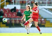 3 April 2021; Emily Whelan of Shelbourne has a shot on goal despite the efforts of Lauren Walsh of Cork City during the SSE Airtricity Women's National League match between Cork City and Shelbourne at Turners Cross in Cork. Photo by Eóin Noonan/Sportsfile