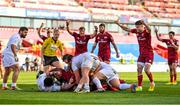 3 April 2021; Munster players, including Conor Murray, right, celebrate after Gavin Coombes, hidden, scores his side's third try during the Heineken Champions Cup Round of 16 match between Munster and Toulouse at Thomond Park in Limerick. Photo by Brendan Moran/Sportsfile