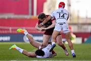 3 April 2021; Chris Farrell of Munster is tackled by Dimitri Delibes, right, and Cheslin Kolbe, both of Toulouse, during the Heineken Champions Cup Round of 16 match between Munster and Toulouse at Thomond Park in Limerick. Photo by Brendan Moran/Sportsfile