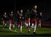 3 April 2021; Andy Lyons of Bohemians, right, warms-up alongside team-mates before the SSE Airtricity League Premier Division match between Bohemians and St Patrick's Athletic at Dalymount Park in Dublin. Photo by Seb Daly/Sportsfile