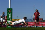 3 April 2021; Antoine Dupont of Toulouse dives to score his side's fourth try during the Heineken Champions Cup Round of 16 match between Munster and Toulouse at Thomond Park in Limerick. Photo by Ramsey Cardy/Sportsfile
