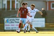 3 April 2021; Darren Murphy of Cobh is tackled by Paul Doyle of UCD during the SSE Airtricity League First Division match between Cobh Ramblers and UCD at St Colman's Park in Cobh, Cork. Photo by Eóin Noonan/Sportsfile