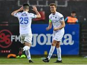 3 April 2021; Jack Keaney of UCD celebrates with teammate Evan Weik after scoring his side's third goal during the SSE Airtricity League First Division match between Cobh Ramblers and UCD at St Colman's Park in Cobh, Cork. Photo by Eóin Noonan/Sportsfile