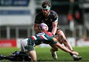 3 April 2021; Tom Daly of Connacht is tackled by Johnny McPhillips of Leicester Tigers during the European Rugby Challenge Cup Round of 16 match between Leicester Tigers and Connacht at Welford Road in Leicester, England. Photo by Matt Impey/Sportsfile