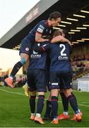 3 April 2021; Ronan Coughlan of St Patrick's Athletic, hidden, celebrates with team-mates after scoring his side's first goal during the SSE Airtricity League Premier Division match between Bohemians and St Patrick's Athletic at Dalymount Park in Dublin. Photo by Seb Daly/Sportsfile