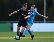 3 April 2021; Ciara Rossiter of Wexford Youths in action against Kerri Letmon of DLR Waves during the SSE Airtricity Women's National League match between DLR Waves and Wexford Youths at UCD Bowl in Belfield, Dublin. Photo by Piaras Ó Mídheach/Sportsfile