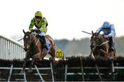 4 April 2021; Skyace, left, with Jody McGarvey up, jumps the last on their way to winning the Irish Stallion Farms EBF Mares Novice Hurdle Championship Final, from second place Gauloise, right, with Paul Townend up, on day two of the Fairyhouse Easter Festival at the Fairyhouse Racecourse in Ratoath, Meath. Photo by Seb Daly/Sportsfile