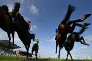 4 April 2021; A view of the field as they jump the last during the first circuit of the BoyleSports Novice Handicap Steeplechase on day two of the Fairyhouse Easter Festival at the Fairyhouse Racecourse in Ratoath, Meath. Photo by Seb Daly/Sportsfile