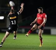 4 April 2021; Stuart McCloskey of Ulster kicks past James Lang of Harlequins during the European Rugby Challenge Cup Round of 16 match between Harlequins and Ulster at The Twickenham Stoop in London, England. Photo by Matt Impey/Sportsfile