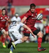 3 April 2021; CJ Stander of Munster is tackled by Zack Holmes of Toulouse during the Heineken Champions Cup Round of 16 match between Munster and Toulouse at Thomond Park in Limerick. Photo by Ramsey Cardy/Sportsfile