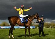 5 April 2021; Jockey Ricky Doyle celebrates on Freewheelin Dylan with stablehand Molly O'Connor after winning the BoyleSports Irish Grand National Steeplechase during day three of the Fairyhouse Easter Festival at the Fairyhouse Racecourse in Ratoath, Meath. Photo by Harry Murphy/Sportsfile