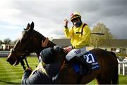 5 April 2021; Jockey Ricky Doyle celebrates on Freewheelin Dylan after winning the BoyleSports Irish Grand National Steeplechase during day three of the Fairyhouse Easter Festival at the Fairyhouse Racecourse in Ratoath, Meath. Photo by Harry Murphy/Sportsfile