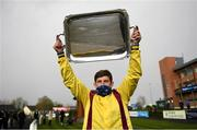 5 April 2021; Jockey Ricky Doyle celebrates with the trophy after riding Freewheelin Dylan to win the BoyleSports Irish Grand National Steeplechase during day three of the Fairyhouse Easter Festival at the Fairyhouse Racecourse in Ratoath, Meath. Photo by Harry Murphy/Sportsfile