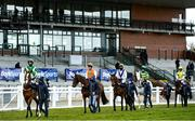 5 April 2021; Runners and riders parade to an empty grand stand prior to the BoyleSports Irish Grand National Steeplechase during day three of the Fairyhouse Easter Festival at the Fairyhouse Racecourse in Ratoath, Meath. Photo by Harry Murphy/Sportsfile